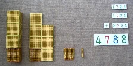 モンテッソーリの教具。<br> ビーズとカードで4桁の演算ができる