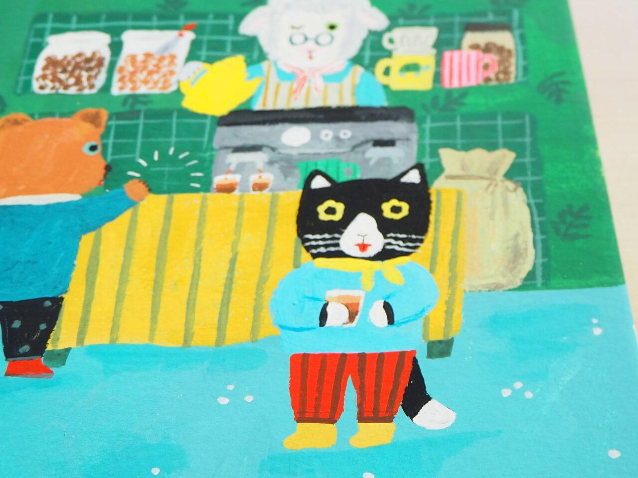 北岸さんお気に入りの黒ネコのマルちゃん。<br> 「ココアだと思ったら、コーヒーで。苦くって、泣いてるところです(笑) イラストだとこんな表情を描くことはあまりないので、新鮮でした」